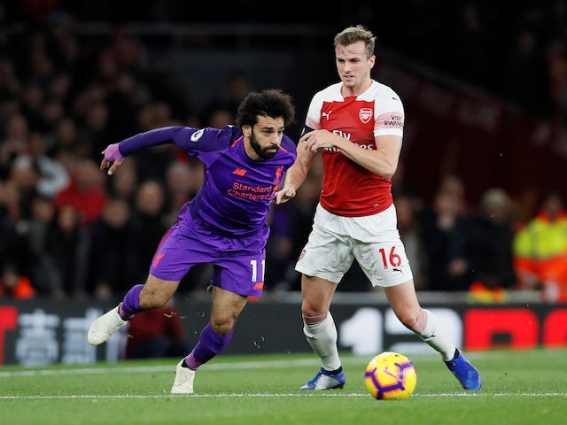 Mohamed Salah and Rob Holding in action during the Premier League game between Arsenal and Liverpool on November 3, 2018