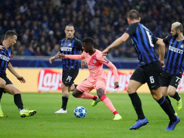 Barcelona forward Ousmane Dembele wriggles away from four Inter Milan players on November 6, 2018