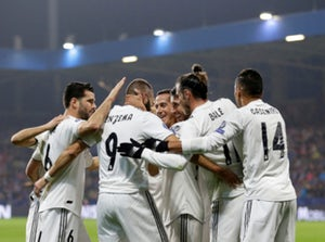 Real Madrid striker Karim Benzema celebrates with his teammates after scoring his second of the night against Viktoria Plzen on November 7, 2018