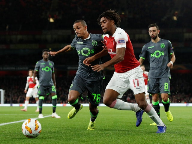 Sporting Lisbon's Bruno Gaspar in action with Arsenal's Alex Iwobi in the sides' goalless draw on November 8, 2018