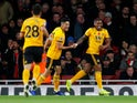 Ivan Cavaleiro celebrates with Raul Jimenez after opening the scoring for Wolverhampton Wanderers against Arsenal on November 11, 2018