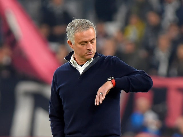 Jose Mourinho looks at his watch prior to the Champions League group game between Juventus and Manchester United on November 7, 2018