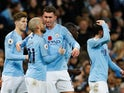 David Silva celebrates with his Manchester City teammates after giving his side the lead in the Manchester derby on November 11, 2018