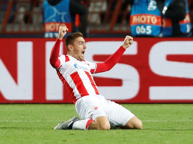 Red Star Belgrade striker Milan Pavkov celebrates after opening the scoring against Liverpool on November 6, 2018