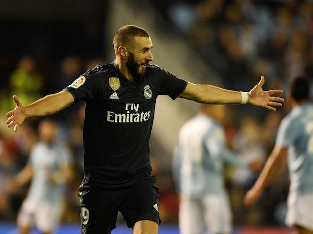 Real Madrid forward Karim Benzema celebrates scoring against Celta Vigo