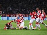 Red Star Belgrade players celebrate Milan Pavkov's goal against Liverpool on November 6, 2018