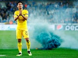 Borussia Dortmund attacker Shinji Kagawa applauds fans after his side's Champions League clash with Club Brugge in September 2018
