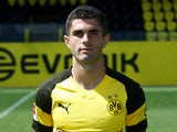 Christian Pulisic poses for his Borussia Dortmund headshot on August 10, 2018