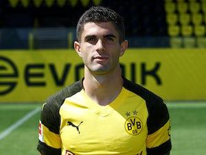 Christian Pulisic poses for his Borussia Dortmund headshot on August 10, 2018