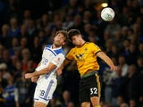 Wolverhampton Wanderers defender Leander Dendoncker challenges Leicester City's Christian Fuchs