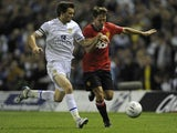 Michael Owen and Jonathan Howson in action during the League Cup game between Manchester United and Leeds United on September 20, 2011