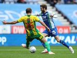 Wigan Athletic's Nick Powell takes on West Bromwich Albion's Craig Dawson on October 20, 2018