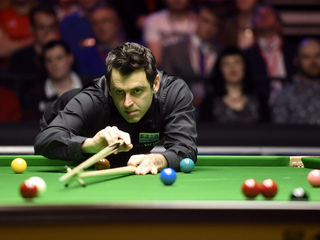 Ronnie O'Sullivan eases past James Cahill after refusing handshake