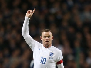 Wayne Rooney playing for England in November 2014