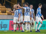 Huddersfield Town midfielder Aaron Mooy celebrates with teammates after scoring against Wolverhampton Wanderers on November 25, 2018