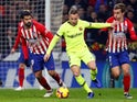 Barcelona's Arthur runs away from Atletico Madrid pair Antoine Griezmann and Diego Costa