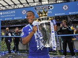 Didier Drogba celebrates after winning the Premier League title with Chelsea in 2014-15