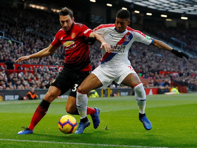 Manchester United's Matteo Darmian battles with Crystal Palace defender Patrick van Aanholt during their Premier League clash on November 24, 2018