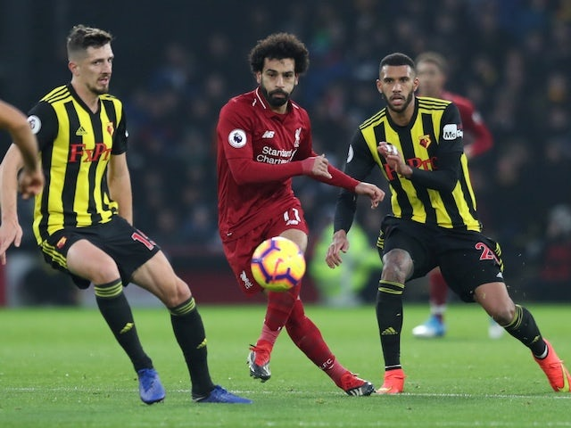 Liverpool's Mohamed Salah flanked by two Watford players during their Premier League clash on November 24, 2018