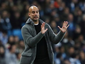 Manchester City manager Pep Guardiola watches on during the Manchester derby in November 2018