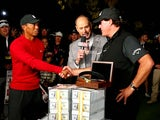 Phil Mickelson and Tiger Woods shake hands after their head-to-head on November 24, 2018