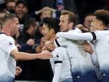Son Heung-min is mobbed by his Tottenham Hotspur teammates after adding his name to the scoresheet against Chelsea on November 24, 2018