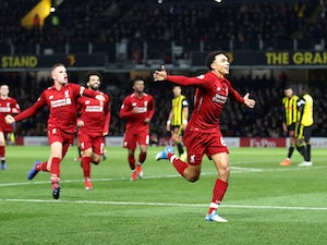Ten-man Liverpool extend unbeaten start