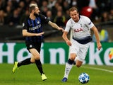 Tottenham Hotspur's Harry Kane and Inter Milan's Marcelo Brozovic compete for the ball on November 28, 2018