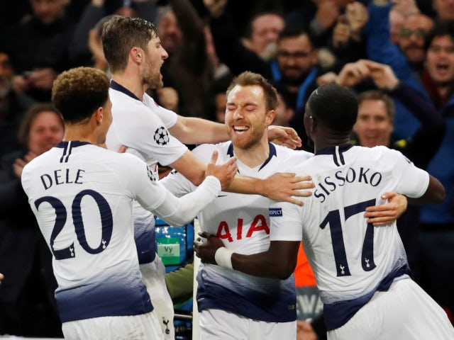 Christian Eriksen is joined in celebration by his Tottenham Hotspur teammates after opening the scoring against Inter Milan on November 28, 2018