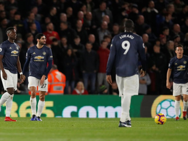 Manchester United's players look dejected after conceding the opening goal to Southampton on December 1, 2018