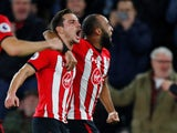 Cedric Soares celebrates Southampton's second goal against Manchester United with teammate Nathan Redmond