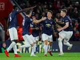 Ander Herrera is congratulated by his teammates after drawing Manchester United level against Southampton on December 1, 2018