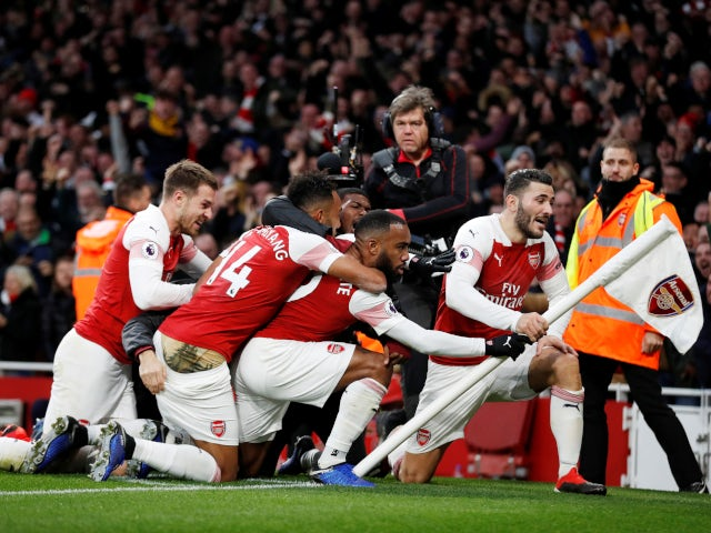 Alexandre Lacazette celebrates Arsenal's crucial third goal with his teammates in the 4-2 win over Tottenham Hotspur on December 2, 2018