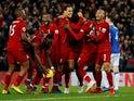 Divock Origi is mobbed by his Liverpool teammates after his dramatic winner against Everton on December 2, 2018