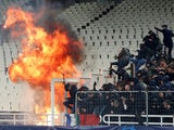 A petrol bomb explodes during the Champions League clash with AEK Athens and Ajax on November 27, 2018