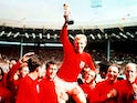 England captain Bobby Moore on shoulders of teammates holding aloft the Jules Rimet trophy in 1966