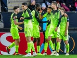 Celtic's Scott Sinclair celebrates scoring the winner with teammates on November 29, 2018