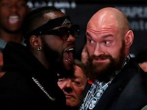 Deontay Wilder and Tyson Fury square up at a press conference on November 28, 2018