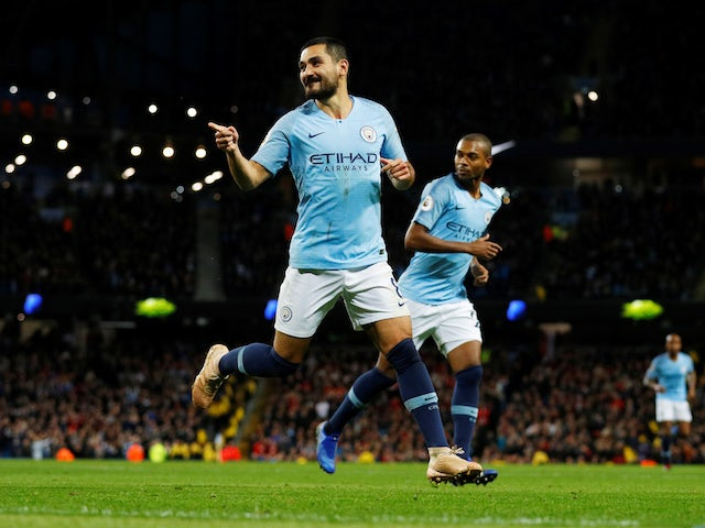 Ilkay Gundogan celebrates scoring his side's third during the Premier League game between Manchester City and Bournemouth on December 1, 2018