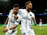 Paris Saint-Germain's Juan Bernat celebrates with Neymar after scoring against Liverpool on November 28, 2018