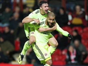 Blades cut down Brentford to stay in touch at the top