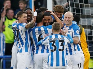 Mathias Jorgensen celebrates his early opener with teammates during the Premier League game between Huddersfield Town and Brighton & Hove Albion on December 1, 2018
