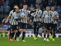 Newcastle United's Ciaran Clark celebrates scoring their second goal against Burnley with teammates on November 26, 2018