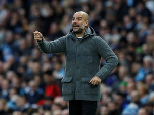 Pep Guardiola watches on during the Premier League game between Manchester City and Bournemouth on December 1, 2018