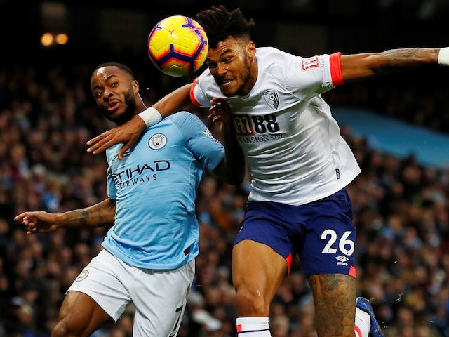 Raheem Sterling and Tyrone Mings in action during the Premier League game between Manchester City and Bournemouth on December 1, 2018