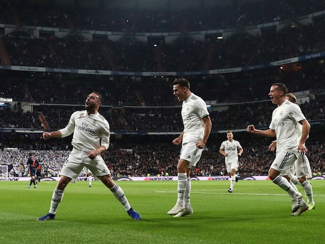 Real Madrid's Dani Carvajal celebrates with teammates against Valencia on December 1, 2018