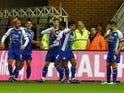 Wigan Athletic players celebrate after scoring against Blackburn Rovers on November 28, 2018