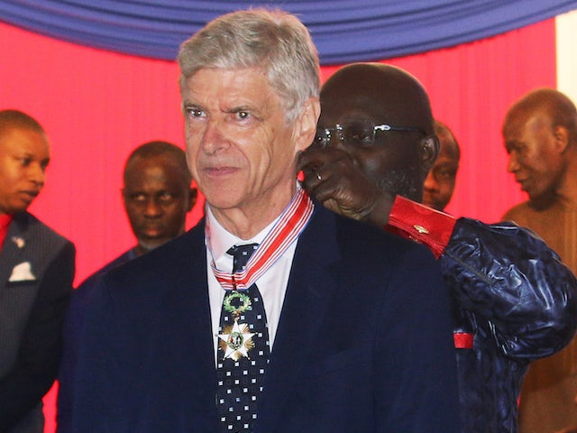 Arsene Wenger picks up an award in Liberia on August 24, 2018