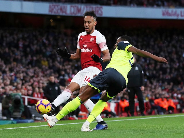 Arsenal's Pierre-Emerick Aubameyang in action with Huddersfield Town's Terence Kongolo on December 8, 2018