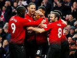 Manchester United's Ashley Young celebrates with teammates after opening the scoring against Fulham on December 8, 2018
